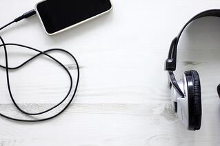 Headphones with smartphone attached.jpeg